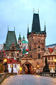 stock photo of old bridge  - The Old Town with Charles bridge in Prague early in the morning - JPG