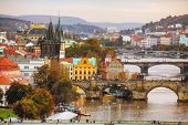 stock photo of old bridge  - Overview of old Prague with Charles bridge before sunset - JPG
