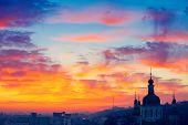 stock photo of kiev  - Orange sunset and cloud over cityscape Kiev - JPG