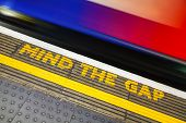 image of gap  - Famous Mind the Gap sign at the underground station in London - JPG