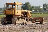 stock photo of dozer  - Old dozer at a construction site - JPG