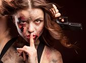 image of girls guns  - Beautiful sexy girl with gun. Posing in studio. With blood on face and wound.