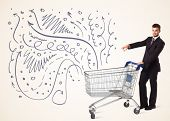 pic of ironic  - Businessman pushing a shopping cart curly lines - JPG