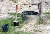 stock photo of wishing-well  - Cement well in the countryside paddy field of Thai farmer - JPG