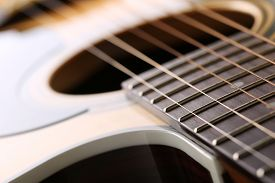 picture of classic art  - Classic acoustic guitar at weird and unusual perspective closeup - JPG