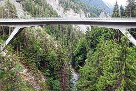picture of sloop  - Mountain landscape with bridge over the canyon - JPG