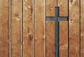 Brown old christian religion symbol cross shape as sign of belief on a grungy textured church wall o poster