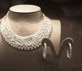 image of chokers  - Sparkling Diamond Necklace and Pair of Earrings on Display in Store Window - JPG