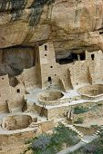 stock photo of cortez  - Cliff Palace one of the most spectacular ancient cliffside villages of the ancient Anasazi people on the mesa top at Mesa Verde National Park near Cortez Colorado in vertical format - JPG