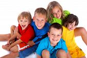 image of children group  - A group of children sit together happily - JPG