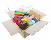 stock photo of spring-cleaning  - Box of used items ready for a garage sale auction or donation to a charitable organization - JPG