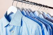 Cloth Hangers With Shirts. Mens Clothes poster