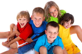 picture of children group  - A group of children sit together happily - JPG