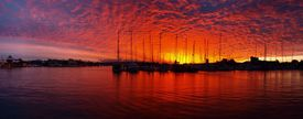 stock photo of safe haven  - Quite an unusual mix of colors in this tropical sunset over a Mooloolaba marina Queensland  - JPG