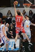 KAPOSVAR, HUNGARY - JANUARY 28: Nik Raivio (white 33) in action at a Hungarian Championship basketba