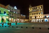 La Plaza Vieja or Old Square , a well known touristic landmark in Old Havana illuminated at night poster