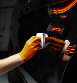 Car Polish Wax Worker Hands Polishing Car. Buffing And Polishing Vehicle With Ceramic. Car Detailing poster