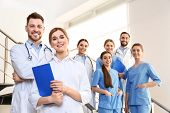 Group Of Medical Doctors At Clinic. Unity Concept poster