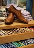 picture of wearing dress  - Display of shoes and neckties in modern upscale men - JPG