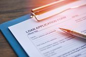 Loan Application Form With Pen On Paper / Financial Loan Negotiation For Lender And Borrower On Busi poster
