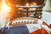 American Football Concept. The Ball For The American Football Lies On The Flag Of America Against Th poster
