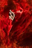 Beautiful Woman In Red Waving Silk Dress As A Fire Flame