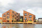 Modern Brick Buildings Houses Along The Canal In Copenhagen, Denmark. Brick Scandinavian Residential poster
