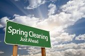 stock photo of flush  - Spring Cleaning Just Ahead Green Road Sign with Dramatic Clouds - JPG