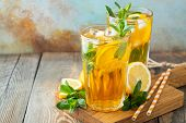 Traditional Iced Tea With Lemon And Ice In Tall Glasses On A Wooden Rustic Table. With Copy Space poster