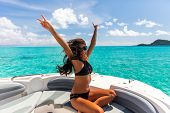 Luxury yacht party woman enjoying freedom having fun with arms up in the wind on high end boat summe poster