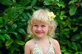 beautiful little girl with plumeria