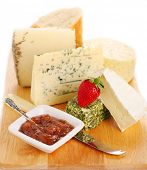 Cheese platte with organic fresh cheese on white isolated background