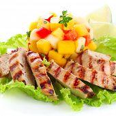 Grilled chicken breast with fresh mango salsa, soft focus