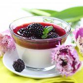 dessert with blackberries and cream