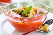 cold gazpacho with garlic croutons in glass bowl