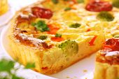cheese quiche with broccoli, cauliflower, carrots and tomatoes