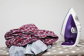 Dry Clothes And Modern Flat Iron On The Ironing Board. Housework. Routine, Clean Clothes poster