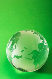 pic of environmentally friendly  - glass globe on green background copy space for text included - JPG