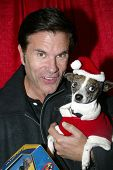 UNIVERSAL CITY - DEC. 4: Lorenzo Lamas & his dog Blueberry arrive at publicist Mike Arnoldi's birthday celebration & Britticares Toy Drive for Children's Hospital on Dec. 4, 2012, Universal City, CA.