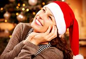 Christmas Woman.Happy Surprised Girl at home. Christmas Wishes