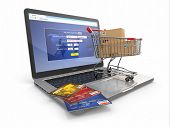 E-commerce. Winkelwagen en credit cards op laptop. 3D