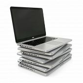 Stack of Laptop on white isolated background. 3d
