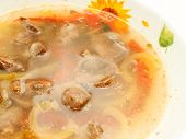 stock photo of giblets  - appetizing Soup with Chicken giblets in plate over white - JPG