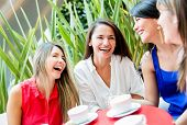 Group of girls having a coffee and talking