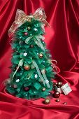 Handmade Christmas Tree on Red Drapery