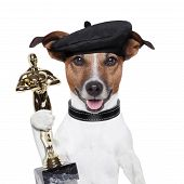 foto of superstars  - award winner director dog holding a statue - JPG