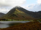 Mountain In Winter Rising Above Lake Buttermere In The Lake Dist