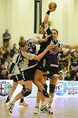 SIOFOK, HUNGARY - NOVEMBER 17: Annamaria Bogdanovic (black 14) in action at EHF Cup handball match Siofok (black) (HUN) vs. Astrakhanochka (purple) (RUS) November 17, 2012 in Siofok, Hungary.