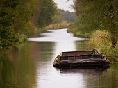 Old Vintage Barge In A Dutch Natural Canal