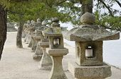 Row Of Stone Lanterns In Japan